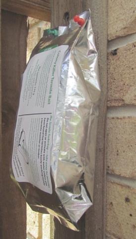 Termite research - termitebait on a post